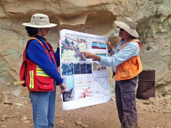 two instructors explaining geology in the field
