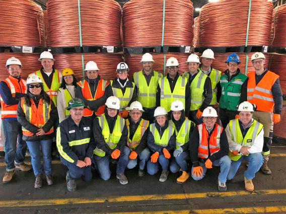 Mining360 participants in front of copper coils