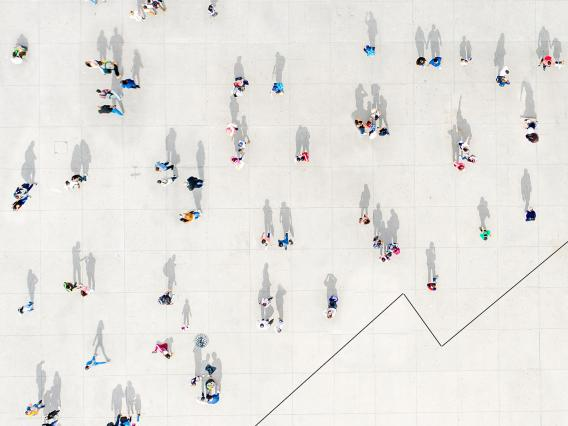 People seen from above and a line graph