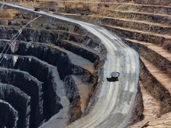 A large haul truck driving out of the Cowal open pit gold mine