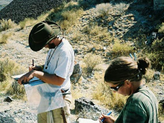 two tudents mapping in the field