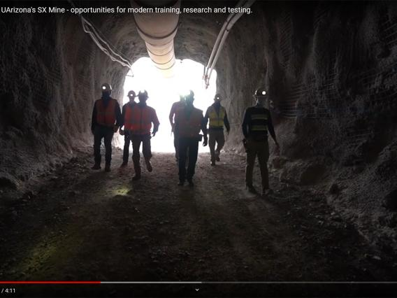 students at the entrance of the SX mine
